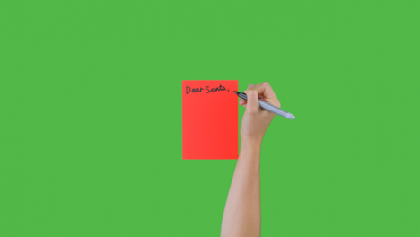 Woman-Writing-Dear-Santa-on-Paper-with-Green-Screen