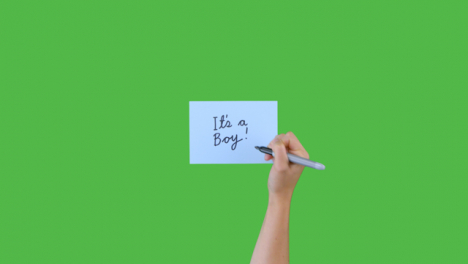 Woman-Writing-Its-a-Boy-on-Paper-with-Green-Screen