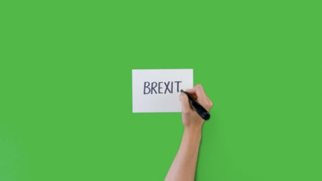 Woman-Writing-Brexit-on-Paper-with-Green-Screen