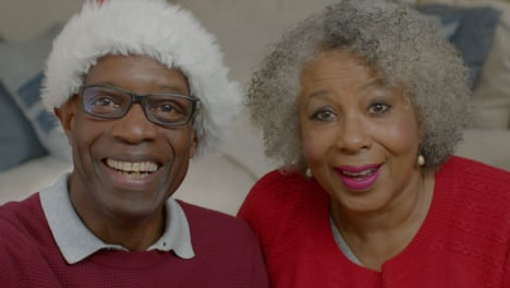 Older-Couple-Listening-Intently-During-Christmas-Video-Call