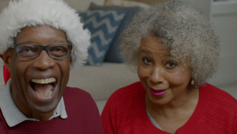 Older-Couple-Talking-and-Laughing-During-Christmas-Video-Call
