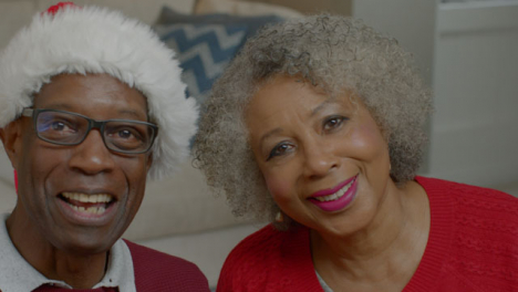 Older-Couple-Talking-and-Laughing-During-a-Christmas-Video-Call
