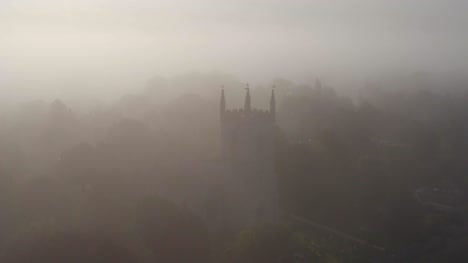 Drone-Shot-Approaching-Islip-Church-In-Mist-01