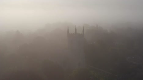 Drone-Shot-Approaching-Islip-Church-In-Mist-01