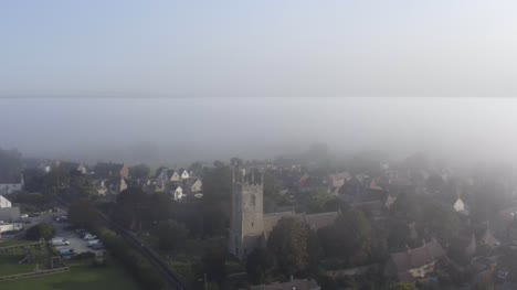 Drone-Shot-Pulling-Away-from-Islip-Church-In-Mist-01