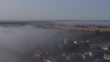 Drone-Shot-Orbiting-Islip-Church-In-Mist-05