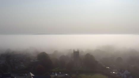 Drone-Shot-Orbiting-Islip-Church-In-Mist-06