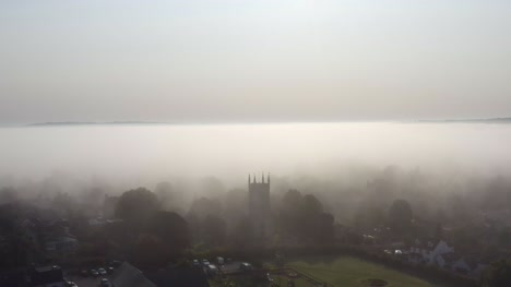 Drone-Shot-Orbiting-Islip-Church-In-Mist-07