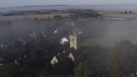 Drone-Shot-Orbiting-Islip-Church-In-Mist-08