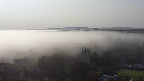 Drone-Shot-Approaching-Islip-Church-In-Mist-02