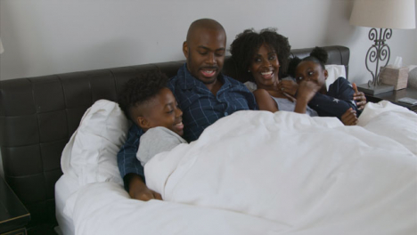 Parents-Children-Snuggle-with-Them-In-Their-Bed