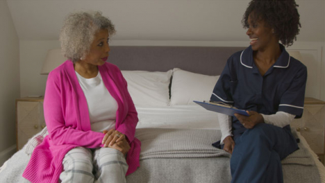 Middle-Aged-Nurse-Conducts-Home-Visit-with-Senior-Woman