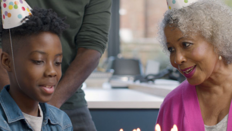 Family-Singing-Happy-Birthday-for-a-Young-Boy-