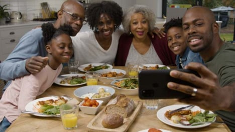 Family-Taking-a-Selfie-Together-During-Family-Dinner-