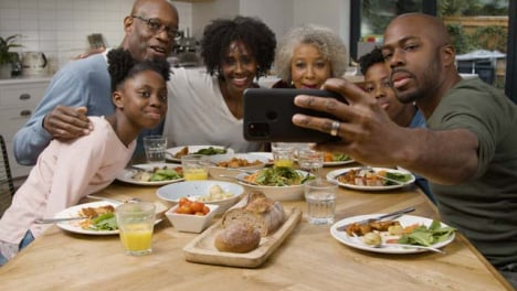 Family-Taking-a-Selfie-Together-During-a-Family-Dinner-