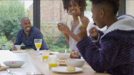 Family-Talking-and-Laughing-Together-Over-Breakfast