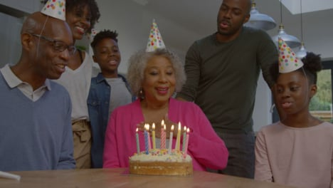 Family-Singing-Happy-Birthday-for-Elderly-Relative-Before-She-Blows-Out-Candles
