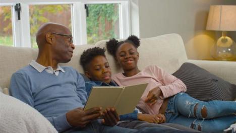Grandfather-Reading-a-Story-Book-to-Grandchildren