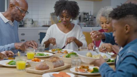 Family-Begin-Eating-Evening-Dinner-Together-