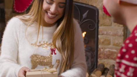 Close-Up-Shot-of-Young-Woman-Opening-Christmas-Gift-From-Boyfriend