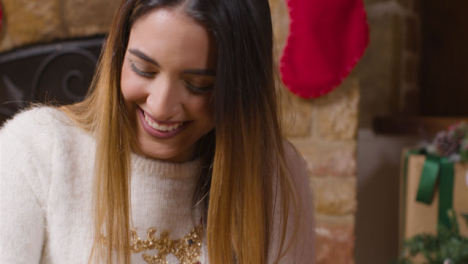 Close-Up-Shot-of-Young-Womans-Reaction-As-She-Opens-a-Christmas-Gift-From-Boyfriend