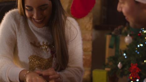 Close-Up-Shot-of-Young-Woman-Reacting-to-Bracelet-Christmas-Gift-From-Boyfriend