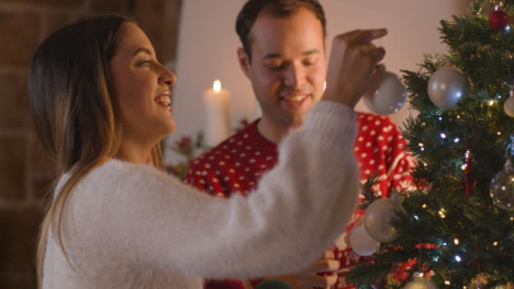 Tracking-Shot-Approaching-Couple-Decorating-Christmas-Tree-Together