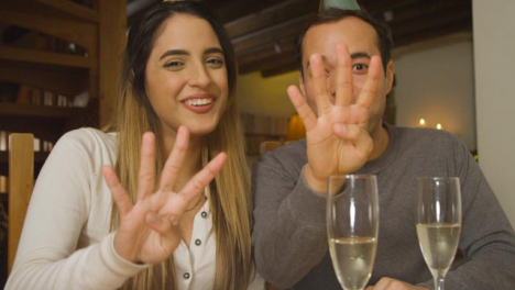 Young-Couple-Counting-Down-and-Celebrating-Turn-of-New-Year-During-Video-Call-