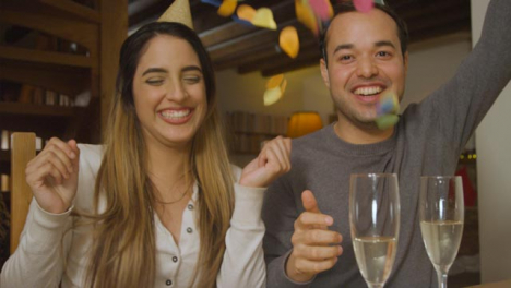 Young-Couple-Counting-Down-and-Celebrating-Turn-of-the-New-Year-During-Video-Call-