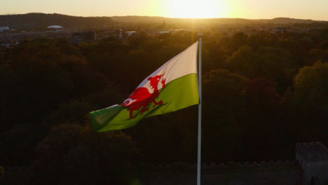 Drone-Shot-Orbiting-Cardiff-Castles-Welsh-Flag-03