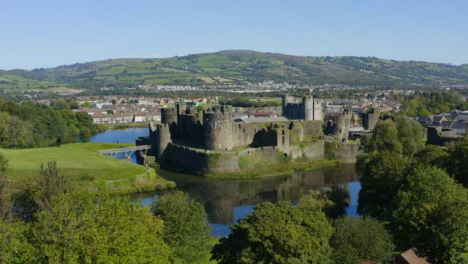 Drone-Shot-Orbiting-Caerphilly-Castle-and-Moat-In-Wales-Short-Version-1-of-2