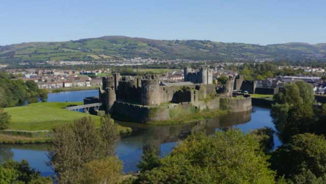 Drone-Shot-Orbiting-Over-Caerphilly-Castle-and-Moat-In-Wales-Long-Version