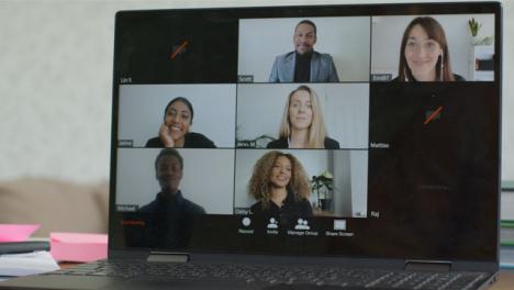 Sliding-Medium-Shot-of-Laptop-Screen-as-People-Join-Video-Call