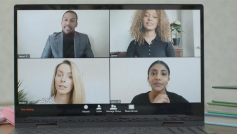 Sliding-Medium-Shot-of-Laptop-Screen-with-Four-People-In-Business-Video-Call