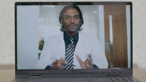 Sliding-Medium-Shot-of-Laptop-Screen-with-Doctor-On-Video-Call