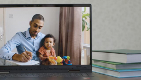 Sliding-Medium-Shot-of-Laptop-Screen-with-Working-Father-and-Baby-On-a-Video-Call