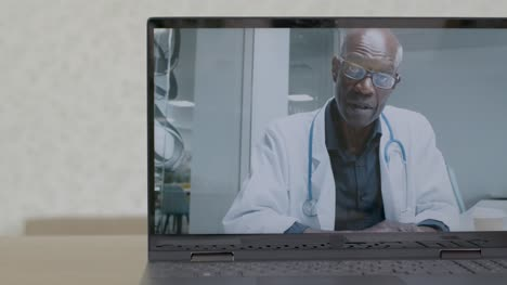 Sliding-Medium-Shot-of-a-Laptop-Screen-with-Doctor-On-a-Video-Call