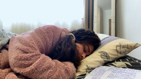 A-Young-Female-Student-Asleep-During-Video-Lecture-and-Abruptly-Waking-Up
