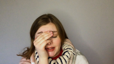 Female-Young-Student-Looking-Visibly-Unwell-Coughing-Whilst-Talking-to-Camera-On-Video-Call