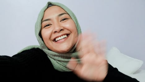 Female-Student-Waving-Talking-and-Waving-Directly-to-Camera