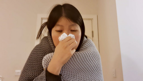 Older-Student-Looking-Visibly-Unwell-Coughing-Whilst-Talking-to-Camera-On-Video-Call