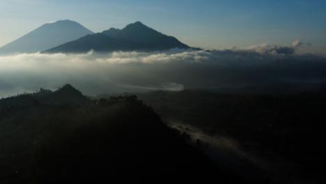 Drone-Shot-Orbiting-Mount-Batur-Volcano-In-Distance