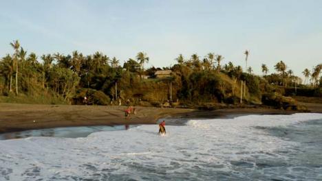 Drone-Shot-Orbiting-Horse-Riders-On-Pigstone-Beach-