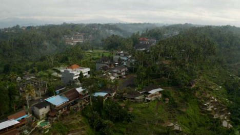 Drone-Shot-Flying-Over-Road-Near-Tegallalang-Terraces