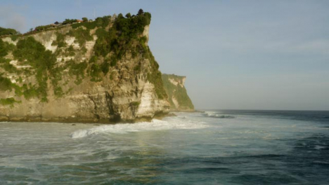 Drone-Shot-Flying-Over-Waves-at-Shore-of-Uluwatu