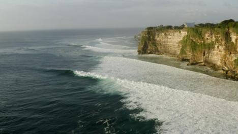 Drone-Shot-Flying-High-Above-Waves-at-Uluwatu-Coast