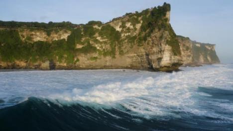 Drone-Shot-Flying-Over-Waves-at-Coast-of-Uluwatu
