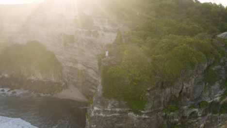 Drone-Shot-Orbiting-Person-Standing-On-Cliff-Edge-