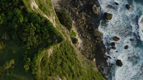 Drone-Shot-Ascending-Above-Group-of-People-Socialising-Near-Cliff-Edge-