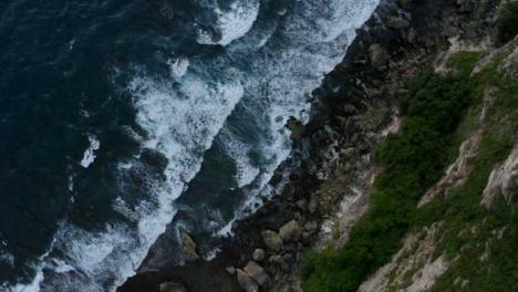 Drone-Shot-Ascending-Above-Uluwatu-Coast-Waves-